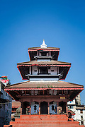 Maju Deval in Kathmandu's Durbar Square is a popular gathering place for locals and tourists alike. The temple itself dates from 1690.