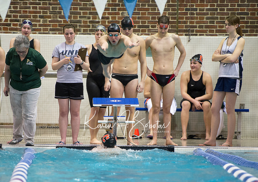 Concord's James Schumacher takes off from the platform for the Butterfly leg of the 200 yard Medley Relay during NHIAA Division I Swimming and Diving Championships at UNH Sunday afternoon.  (Karen Bobotas/for the Concord Monitor)