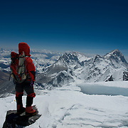 Climber John Griber gazes eastward at the Himalayan giants of Makalu, Chomolhunzo, and distant Kangchenjunga, from the South Col on Mount Everest, Nepal.