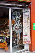 A bakery decorated with skeletons for the Day of the Dead festival known in spanish as Día de Muertos in Oaxaca, Mexico.