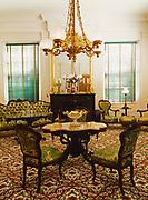 Original McMurran family furniture including revolving game sofa, Drawing Room at the antebellum home of Melrose, Natchez National Historical Park, Mississippi.
