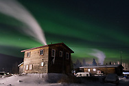 The Aurora Borealis shines overhead as smoke rises from two homes in Nenana, Alaska. Made on February 28, 2020, 11:10pm -34F