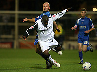 Photo: Rich Eaton.<br /> <br /> Peterborough United v Swansea City. Johnstone's Paint Trophy. 31/10/2006. Peterboroughs Guy Branston at rear fouls Adebayo Akinfenwa of Swansea