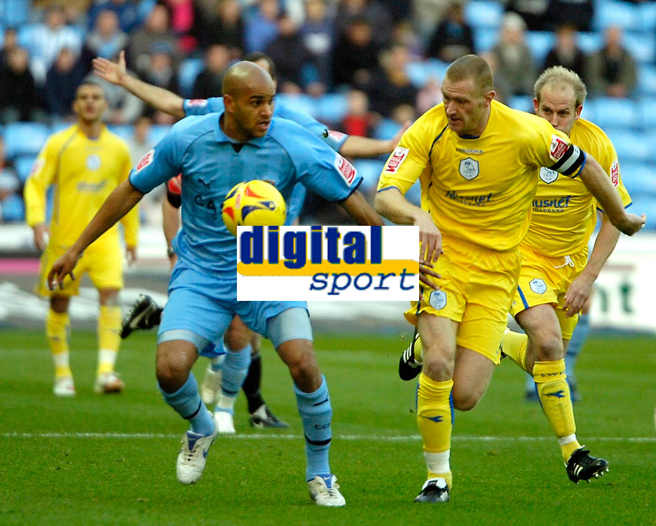 Photo: Ed Godden.<br />Coventry City v Sheffield Wednesday. Coca Cola Championship. 18/11/2006. Leon McKenzie (L),is challenged by Wednesday's Lee Bullen.