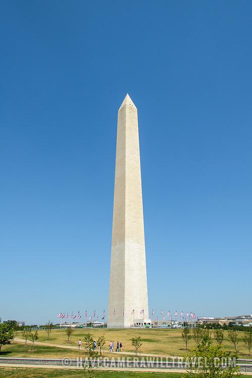 Washington Monument with Clear Blue Sky. The Washington Monument, one of the National Mall's most distinctive landmarks, on a clear sunny day with blue sky.