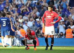 Manchester United's Ashley Young (left) and Chris Smalling look dejected after the game