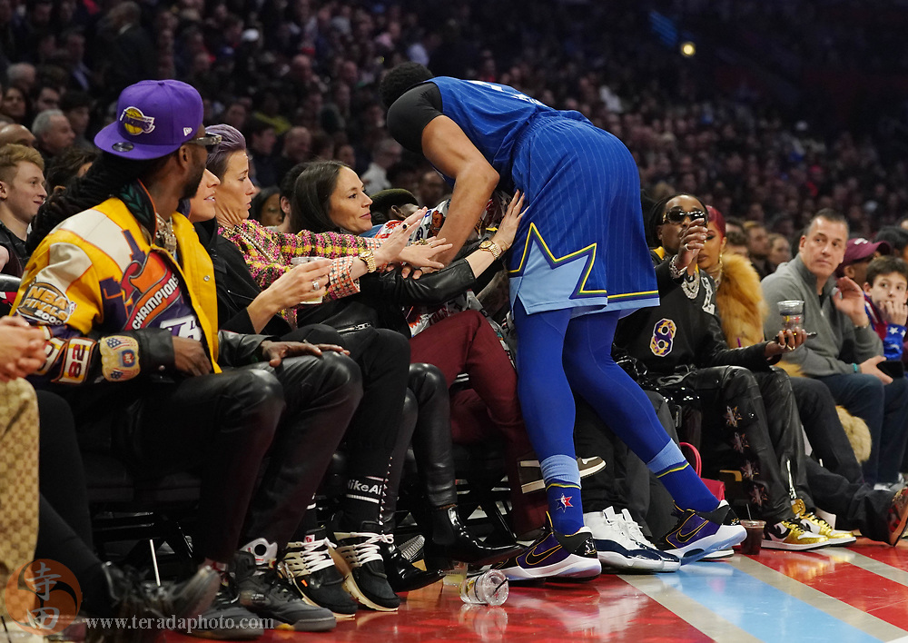 Feb 16, 2020; Chicago, Illinois, USA; Team LeBron forward Anthony Davis of the Los Angeles Lakers falls into the stands next to WNBA player Sue Bird and soccer player Megan Rapinoe during the third quarter of the 2020 NBA All Star Game at United Center.