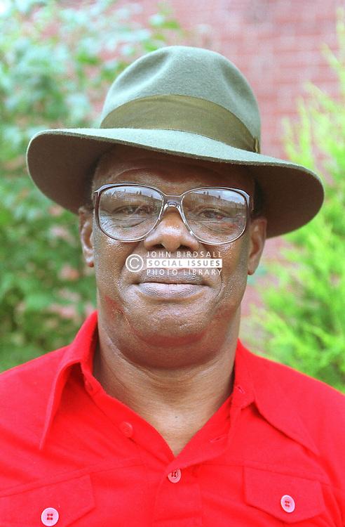 Portrait of elderly man wearing hat looking serious,