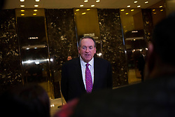 Mike Huckabee, former governor of Arkansas speaks to members of the media inside of the lobby of Trump Tower in Manhattan, New York, U.S., on Friday, November 18, 2016. POOL PHOTO BY John Taggart/Bloomberg