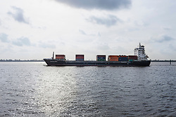 Container ship sailing on river Elbe, Hamburg, Germany, Europe