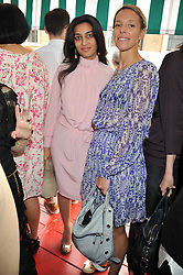 Left to right, MEGHA MITTAL and TIPHAINE CHAPMAN at a lunch to celebrate the the Lulu & Co Autumn/Winter 2011 collection held at Harry's Bar, 26 South Audley Street, London W1 on 21st June 2011.