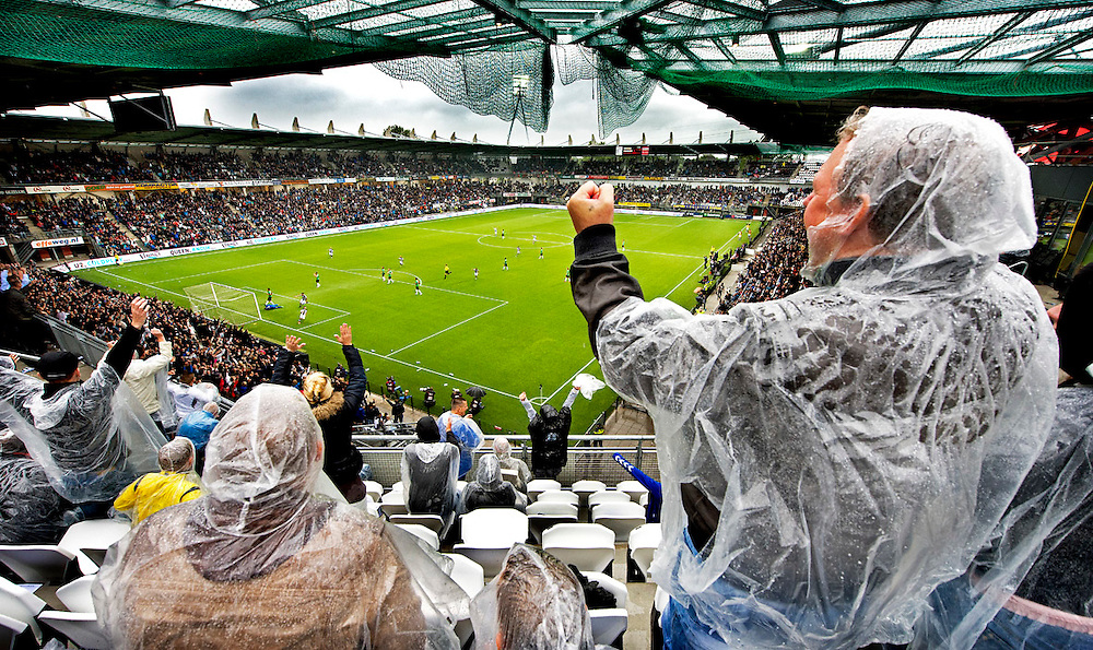The Netherlands, Almelo, 16-08-2015<br /> Football, National, Competition, Eredvisie.<br /> Heracles - NEC <br /> In the not yet completelycovered stadium of Heracles cheer the spectators for the second goal of Heracles that had been made by Thomas Bruns.<br /> Photo: Klaas Jan van der Weij