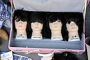 mannequin heads in a a pink suitcase