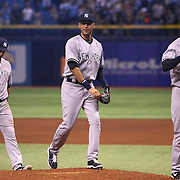 New York Yankees shortstop Derek Jeter (center) walks with teammates to shake hands after a major league baseball game between the New York Yankees and the Tampa Bay Rays at Tropicana Field on Thursday, Sept. 17, 2014 in St. Petersburg, Florida. The Yankees won the game 3-2 and this was Jeter's last game against Tampa Bay. (AP Photo/Alex Menendez)