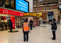 © Licensed to London News Pictures. 28/04/2020. London, UK. Staff and passengers at Victoria Station in Westminster stop for the 1 minute silence for fallen key workers. UK holds a minute silence for key workers who have died in the Coronavirus pandemic as the Office for National Statistics reveals there were 1000s of more deaths due to Covid-19 outside of hospitals as the coronavirus pandemic crisis continues. Photo credit: Alex Lentati/LNP