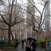 Tourists take pictures of Madison Square park under the rain in Manhattan, new York City