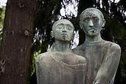 Samaritan and victim bronze statues outside the German Red Cross (Deutsches Rotes Kreuz - DRK) administrative HQ at 58 Carstennstrasse, Berlin.