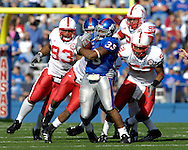 November 3, 2007 - Lawrence, KS..Running back Brandon McAnderson #35 of the Kansas Jayhawks is chased down from behind by defenders Ndamukong Suh #93, Phillip Dillard #52 and Zach Potter #98 of the Nebraska Cornhuskers in the second half, during a NCAA football game at Memorial Stadium on November 3, 2007...FBC:  The Jayhawks defeated the Huskers 76-39.  .Photo by Peter G. Aiken/Cal Sport Media