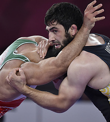 Jakarta, Aug. 19, 2018  Alireza Karimimachiani (L) of Iran competes during Men's Wrestling Freestyle 97 kg Final against Magomed Musaev of Kyrgyzstan at the 18th Asian Games at Jakarta, Indonesia, Aug. 19, 2018. (Credit Image: © Lihe/Xinhua via ZUMA Wire)