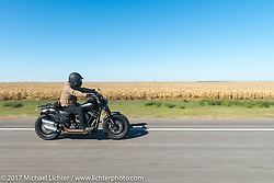 Meta Magazine publisher Andrew Campo riding a 2018 Harley-Davidson Fat Bob with it's Milwaukee-8 engine in the new Softail frame for the USS South Dakota submarine flag relay across South Dakota on the first day from Sturgis to Aberdeen. SD. USA. Saturday October 7, 2017. Photography ©2017 Michael Lichter.