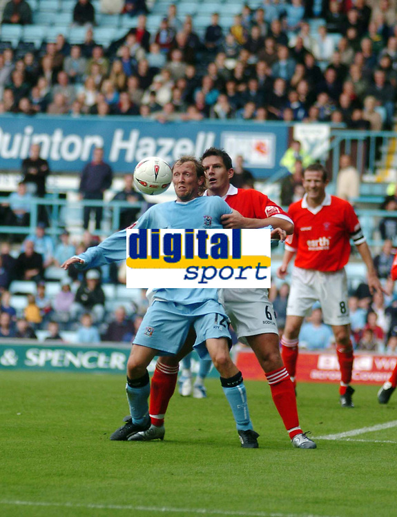 Photo. Leigh Quinnell.  Coventry City v Rotherham United. Coca Cola championship. 18/09/2004.<br /> Andy Morrell of coventry holds off Phil Gilchrist of Rotherham