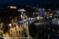 People wandering around Boudhanath Stupa in Kathmandu before leaving on Motorcycle Sherpa's Ride to the Heavens motorcycle adventure in the Himalayas of Nepal. Sunday, November 3, 2019. Photography ©2019 Michael Lichter.