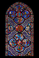 Medieval stained glass Window of the Gothic Cathedral of Chartres, France - dedicated to the Good Samaritan .  Bottom central panel shows Adam dwelling in Paradise, below - At the inn, the Samaritan nurses the injured man back to health, left - God breathing life into Adam, above - God warning Adam and Eve not to eat from the tree of knowledge, right - God creates Eve out of Adam's rib . Small central oval panel - Tempted by the serpent, Eve tastes the forbidden fruit , left side panel - Adam and Eve conversing beneath the tree of knowledge, right side panel -  God finds Adam and Eve hiding their nakedness. Top centre panel - God instructing Adam and Eve how to live in the wilderness, below - An angel casts Adam and Eve out of Paradise , left - Labouring in the wilderness; Adam digs and Eve spins, right -  Cain murdering his brother Abel with a sickle, above -  Christ in Majesty, seated on the rainbow. A UNESCO World Heritage Site. .<br /> <br /> Visit our MEDIEVAL ART PHOTO COLLECTIONS for more   photos  to download or buy as prints https://funkystock.photoshelter.com/gallery-collection/Medieval-Middle-Ages-Art-Artefacts-Antiquities-Pictures-Images-of/C0000YpKXiAHnG2k