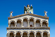 Upper arcades and statue of St Michele of the 13th century Romanesque facade of the San Michele in Foro,  a Roman Catholic basilica church in Lucca, Tunscany, Italy .<br /> <br /> Visit our ITALY PHOTO COLLECTION for more   photos of Italy to download or buy as prints https://funkystock.photoshelter.com/gallery-collection/2b-Pictures-Images-of-Italy-Photos-of-Italian-Historic-Landmark-Sites/C0000qxA2zGFjd_k<br /> <br /> If you prefer to buy from our ALAMY PHOTO LIBRARY  Collection visit : https://www.alamy.com/portfolio/paul-williams-funkystock/lucca.html .<br /> <br /> <br /> Visit our MEDIEVAL PHOTO COLLECTIONS for more   photos  to download or buy as prints https://funkystock.photoshelter.com/gallery-collection/Medieval-Middle-Ages-Historic-Places-Arcaeological-Sites-Pictures-Images-of/C0000B5ZA54_WD0s