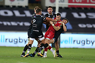 Rhys Webb (l) and Dan Biggar ® of the Ospreys grab hold of Gareth Davies of the Scarlets. Guinness Pro14 rugby match, Ospreys v Scarlets at the Liberty Stadium in Swansea, South Wales on Saturday 7th October 2017.<br /> pic by Andrew Orchard, Andrew Orchard sports photography.