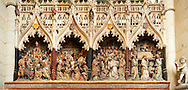 Panorama of Gothic sculptures (1530 ) depicting scenes from the life of St Firmin (3rd century), Cathedral of Notre-Dame, Amiens, France . The Cathedral Basilica of Our Lady of Amiens or simply Amiens Cathedral, is a Roman Catholic  cathedral the seat of the Bishop of Amiens. It is situated on a slight ridge overlooking the River Somme in Amiens. Amiens Cathedral, was built almost entirely between 1220 and c.1270, a remarkably short period of time for a Gothic cathedral, giving it an unusual unity of style. Amiens is a classic example of the High Gothic style of Gothic architecture. It also has some features of the later Rayonnant style in the enlarged high windows of the choir, added in the mid-1250s. Amiens Cathedra has been listed as a UNESCO World Heritage Site since 1981. Photos can be downloaded as Royalty Free photos or bought as photo art prints. <br /> <br /> Visit our MEDIEVAL PHOTO COLLECTIONS for more   photos  to download or buy as prints https://funkystock.photoshelter.com/gallery-collection/Medieval-Middle-Ages-Historic-Places-Arcaeological-Sites-Pictures-Images-of/C0000B5ZA54_WD0s