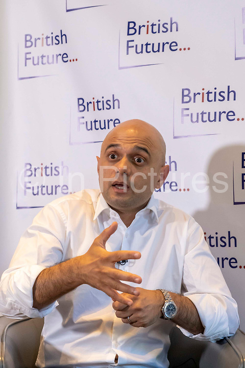 Sajid Javid MP discussing the challenges of identity in British society today, in conversation with Sunder Katwala, Director of thinktankBritish Future at The Royal Society on 6th June 2019 in London, United Kingdom.  Home Secretary Sajid Javid is the first British Asian politician to hold one of the great offices of state. He has declared that he will be a candidate to be the next Prime Minister in the forthcoming Conservative leadership election.