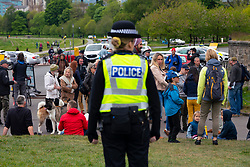 Edinburgh, Scotland, UK. Police watching over a small group of people in Holyrood Park. Possible that one or two members of the public were part of an anti-lockdown protest in the park that was promoted on Facebook this week. No large scale protest is visible in the park at the planned start time however. Iain Masterton/Alamy Live News