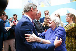 © Licensed to London News Pictures. 27/05/2019. London, UK. Nigel Farage, leader of the Brexit Party and a MEP for South East England is greeted by Ann Widdecombe elected as a MEP for South West England at the EU election results press conference in Westminster. The newly formed Brexit Party wants the UK to leave the EU without an agreement won 10 of the UK's 11 regions, gaining 28 seats, more than 32% of the vote across the country and are largest party in nine regions. Photo credit: Dinendra Haria/LNP