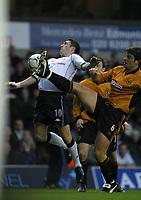 Photo: Jo Caird<br /> Spurs v Wolves<br /> Barclaycard Premiership 2003<br /> 06/12/2003.<br /> <br /> Robbie Keane dodges paul butlers kick