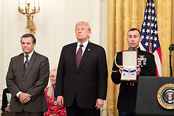 Nov 16, 2018 - Washington, District of Columbia, U.S. - President Donald J. Trump presents the Medal of Freedom to Dallas Cowboy Football Hall of Famer ROGER STAUBACH Friday, Nov. 16, 2018, in the East Room of the White House. (Credit Image: ? White House/ZUMA Wire/ZUMAPRESS.com)