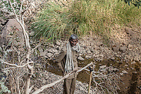 A man rests his axe in Ranthmbhore National Park