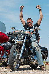 Reality TV show star Moonshiner Josh Owens heading to the ranch on the annual Lichter/Sugar Bear ride during the 75th Annual Sturgis Black Hills Motorcycle Rally.  SD, USA.  August 5, 2015.  Photography ©2015 Michael Lichter.