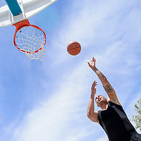 062114       Cable Hoover<br /> <br /> Mike Scott gets clear of the his competitors for a quick layup during a 3-on-3 basketball tournament at Ford Canyon Park in Gallup Saturday.