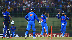 August 24, 2017 - Kandy, Sri Lanka - Indian captain Virat Kohli (R) and Yuzvendra Chahal celebrate after taking the wicket of Sri Lanka's Danushka Gunathilaka during the 2nd One Day International cricket match between Sri Lanka and India at the Pallekele international cricket stadium at Kandy, Sri Lanka on Thursday 24 August 2017. (Credit Image: © Tharaka Basnayaka/NurPhoto via ZUMA Press)