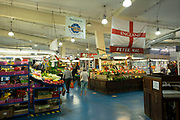 Interior of Coventry Market with a patriotic fruit and vegetable stall adorned with a St Georges Cross flag in the UK City of Culture 2021 on 23rd June 2021 in Coventry, United Kingdom. The market is an indoor market with vendors for fruit, vegetables, meat, fish, artisanal items & secondhand goods. There has een a market on this site since 1958. The UK City of Culture is a designation given to a city in the United Kingdom for a period of one year. The aim of the initiative, which is administered by the Department for Digital, Culture, Media and Sport. Coventry is a city which is under a large scale and current regeneration.