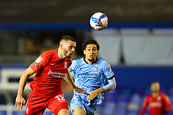 Birmingham City's Harlee Dean heads clear, under pressure from Tyler Walker of Coventry City  - Mandatory by-line: Nick Browning/JMP - 20/11/2020 - FOOTBALL - St Andrews - Birmingham, England - Coventry City v Birmingham City - Sky Bet Championship