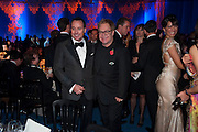 DAVID FURNISH; SIR ELTON JOHN, Grey Goose character and cocktails. The Elton John Aids Foundation Winter Ball. off Nine Elms Lane. London SW8. 30 October 2010. -DO NOT ARCHIVE-© Copyright Photograph by Dafydd Jones. 248 Clapham Rd. London SW9 0PZ. Tel 0207 820 0771. www.dafjones.com.