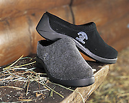 Photograph of two grey flet slippers shot on location for Charles Keath product catalog.