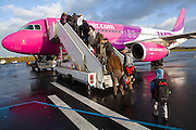 Passengers board a Wizzair flight at Beauvais - Tillé Airport, near Paris, France.