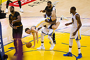 Golden State Warriors forward Draymond Green (23) saves Golden State Warriors guard Klay Thompson (11) from falling during Game 5 of the NBA Finals against the Cleveland Cavaliers at Oracle Arena in Oakland, Calif., on June 12, 2017. (Stan Olszewski/Special to S.F. Examiner)