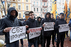 March 27, 2019 - Kyiv, Ukraine - Demonstrators hold placards calling for action during a protest action of the National Corps and the National Militia outside the Security Service building, Kyiv, capital of Ukraine, March 27, 2019. Ukraine's security agency, commonly known as the SBU, carries out counterintelligence and counterterrorism activities. Ukrinform. (Credit Image: © Tarasov/Ukrinform via ZUMA Wire)