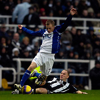 Photo: Jed Wee/Sportsbeat Images.<br /> Newcastle United v Birmingham City. The FA Barclays Premiership. 08/12/2007.<br /> <br /> Birmingham's Sebastian Larsson (L) is tackled by Newcastle's Nicky Butt.