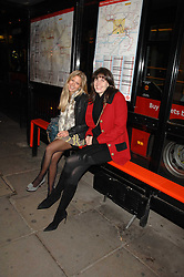 Left to right, GEORGIE DOWNIE and LADY LAURA CATHCART at a party to celebrate the opening of the new Beatrix Ong store in Burlington Arcade, Piccadilly, London on 14th November 2007.<br />