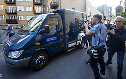 © Licensed to London News Pictures. 20/08/2018. London, UK. Photographers attempt to photograph through the window of an armoured police vehicles carrying Westminster terrorist attack suspect Salih Khater as it arrives at Westminster Magistrates Court in London where he is due to face charges. 29 year-old, Sudanese-born Salih Khater is accused of driving his car at pedestrians and a security barrier at the Houses Of Parliament in London on August 14th, 2018. Photo credit: Ben Cawthra/LNP