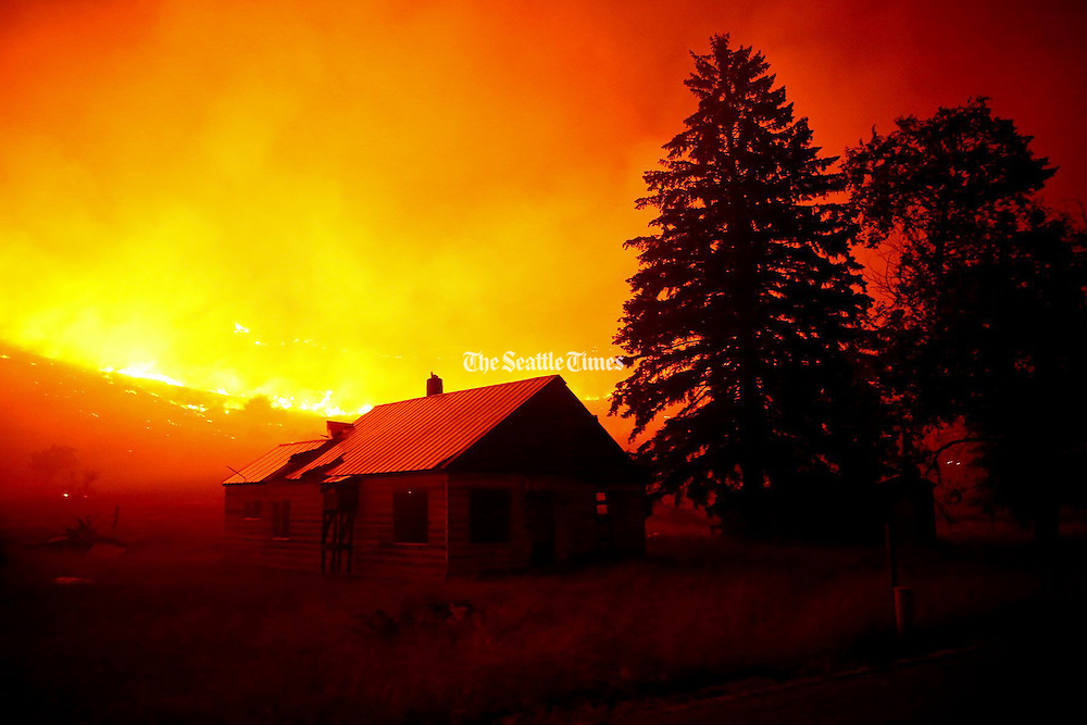 Flames blanket the hillsides on Twisp River Road just outside of the town of Twisp early in the morning Thursday, Aug. 20, 2015. <br /> <br /> Erika Schultz / The Seattle Times